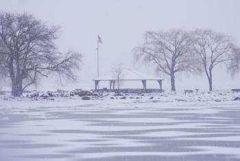 Wintry view of Senasqua Park and frozen part of Hudson River.