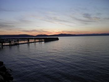 Sunset at empty docks along Hudson River.