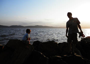 Father and Son on the Rocks. © 2015 Peter Wetzel.
